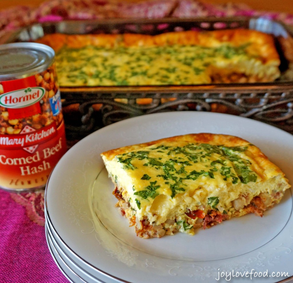 Corned Beef Hash and Egg Casserole with Sun-Dried Tomatoes and Swiss Cheese